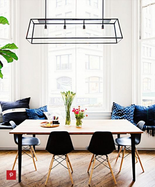 Bright Dining Space With A Large Pendant Light And Bench Built In Seating