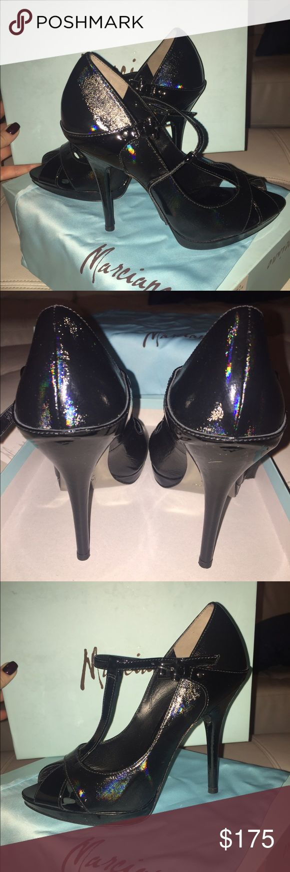Marciano Black T-Strap Stiletto High Heels Marciano Black T-Strap Stiletto High Heels.  Never been worn, any mark on sole would be from in the store. Have receipt and box, cloth bag, etc. New condition with no scratches. Patent leather and almost had a prismatic hue on the heel which is cool how it reflects the light. I've never worn these.  If interested, make me an offer. Marciano Shoes Heels