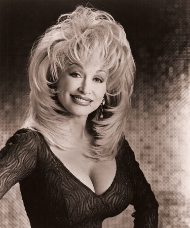 Dolly Parton hairstyle.  This is absolutely the cut that I've been wanting a picture of to take to my stylish.