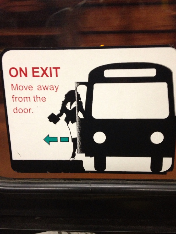 Old sticker on TTC streetcar side doors explaining how to exit.