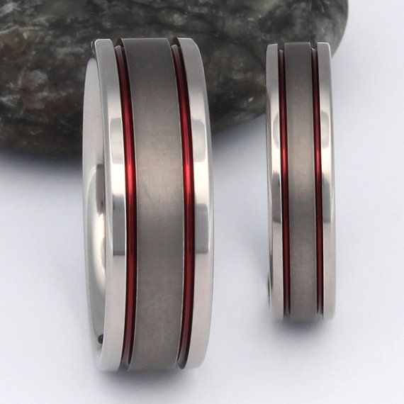 Titanium Wedding Ring Set with Sable Center and Two Thin Red Lines stsa12 Red Flash a spark of fire with this titanium wedding ring set. The unique sable finish down the center of the rings adds a pleasing, rich texture to this stylish set of bands. This set of rings is shown 4 and 7mm wide. Please indicate your preferred widths in the note to seller section when you place your order. We offer FREE ENGRAVING and if you would like a FREE RING SIZER select this option in the size menu at the…