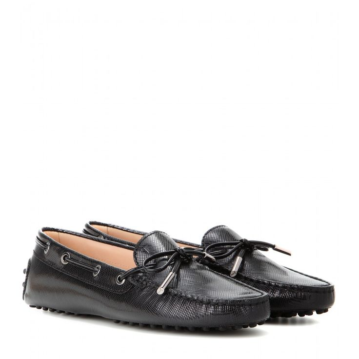 Tod's - Heaven New Laccetto leather loafers - Finish timeless looks with a preppy conclusion in Tod's black leather loafers. Tonal lacing and metal hardware make for a contemporary polish, perfectly sophisticated for all-season wear. seen @ www.mytheresa.com