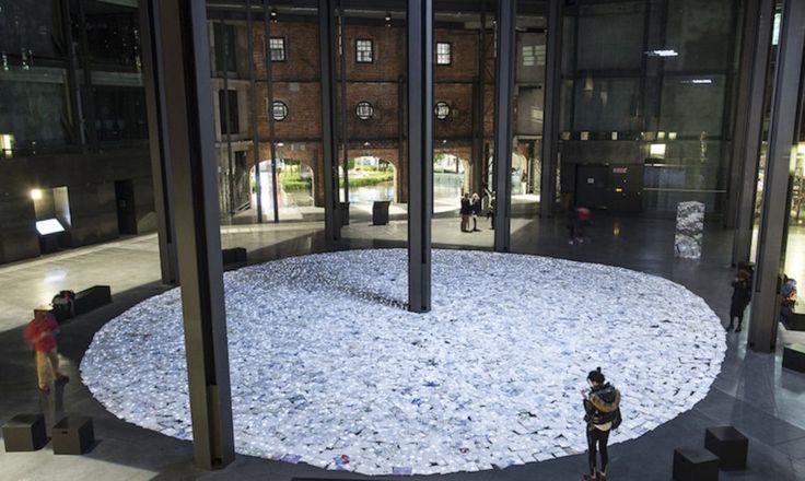 Luzinterruptus designed Denboran Zehar, an art installation for Gutun Zuria made from 5,000 recycled notebooks.