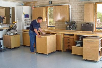 [Click for full-size] I think I pinned this already.  Rolling cabinets fit under workbench tables for efficient conversion between garage and woodshop.