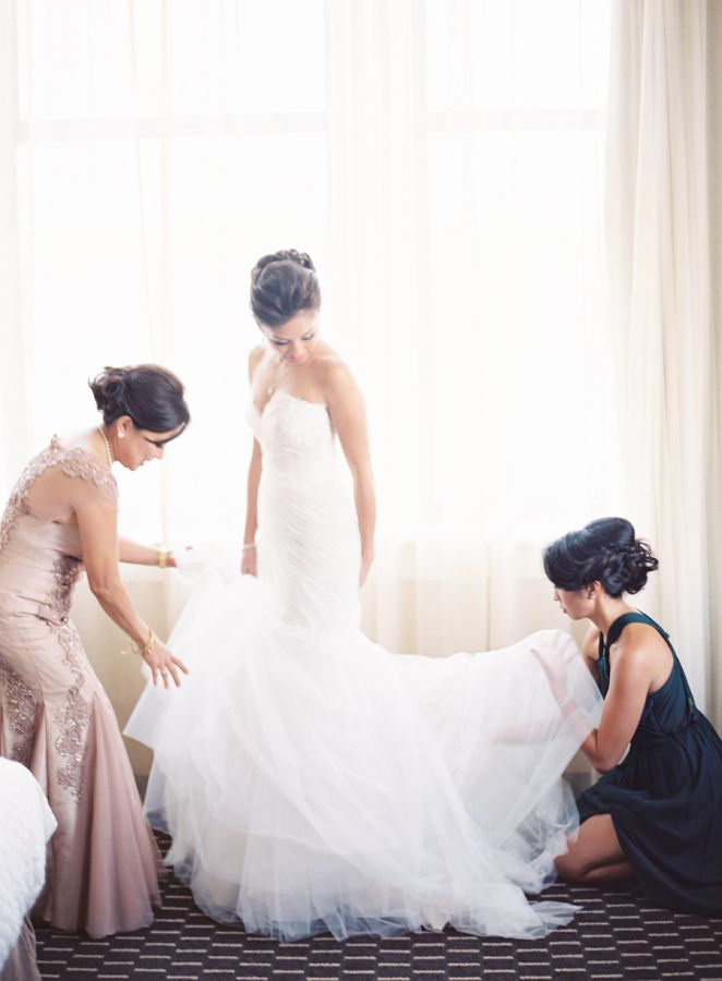 Classic trumpet style wedding dress: http://www.stylemepretty.com/2016/03/03/classic-church-wedding-with-a-touch-of-teal/ | Photography: Clary Pfeiffer - http://claryphoto.com/