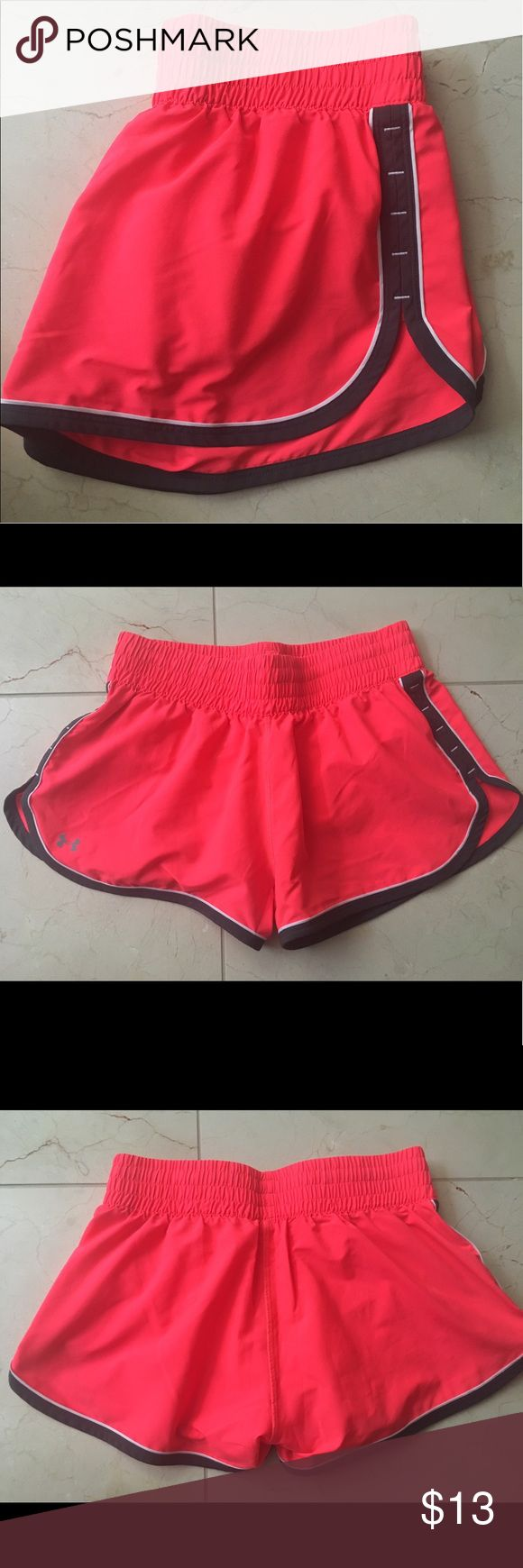 "Under Armour Neon Running Shorts Never worn! 3"" inseam. Neon pink/coral color with white lining. Small pocket on inside lining Under Armour Shorts"