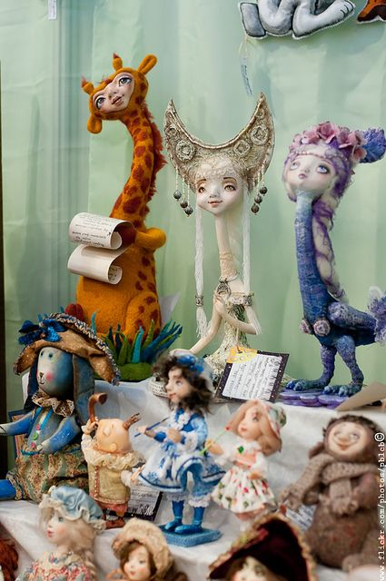 at a Russian doll show, I love the three long necked characters at the back #art_dolls #dolls