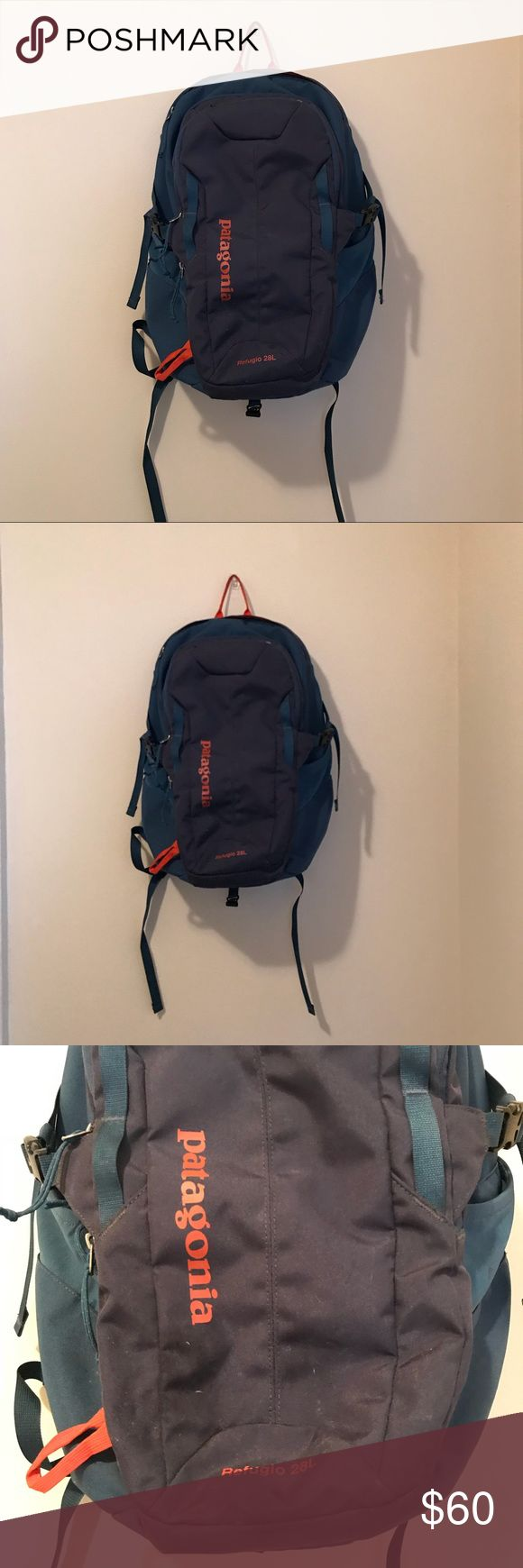 Patagonia backpack Patagonia Refugio backpack 28L. Two shades of blue with orange accents. A couple marks on front bottom near name, as seen in photo.....although I imagine they could be wiped off. Otherwise in excellent condition!! 4 zippered pockets (2 Large, 1 Medium w many organizing pockets (pictured) and 1 small on top). Patagonia Bags Backpacks