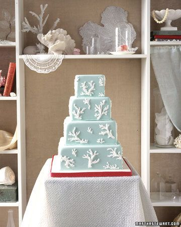 This coral branch wedding cake would fit right in at a beachy summer wedding