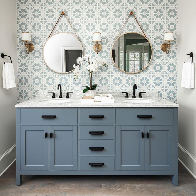 Modern Bathroom With Cement Tile Accent Wall Blue Gray Vanity Black Matte Hardware Round Brass Mirrors Gorgeous Bathroom Bathrooms Remodel Bathroom Design