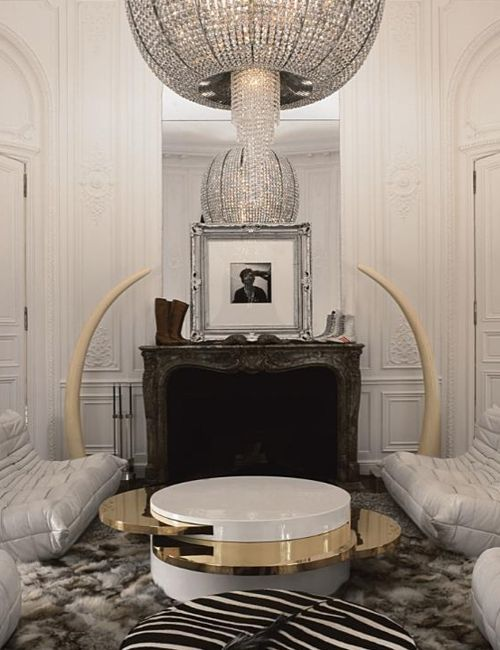 Lenny Kravitz Paris apt living room white glam fur chandelier 1970s brass  table fireplace tusks Best 25 rooms ideas on Pinterest High ceiling