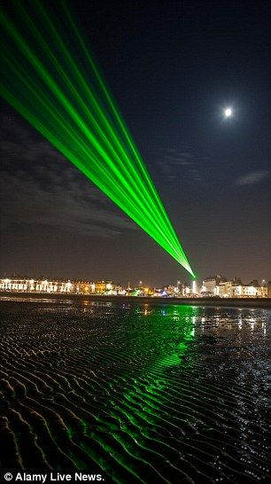 Weymouths' newest visitor attraction the Laser lights. They are the largest permanent unmanned laser show in Europe, and here's an example of them in action. Photo by Alamy Live News