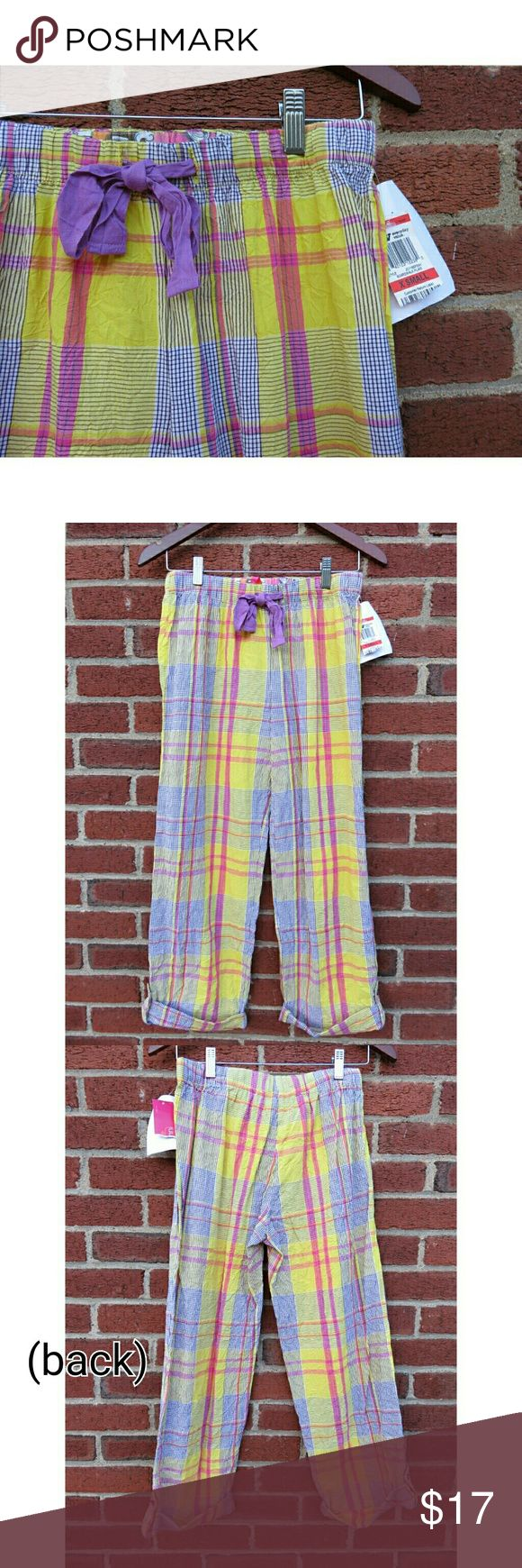 "NWT Plaid PJ Pants Jenni by Jennifer Moore Gift +Jenni by Jennifer Moore /Macy's new with tags and never worn pajama pants. Purple, pink, yellow, and gray plaid/flannel pattern. Drawstring waist, cute button cuff on bottom hem, wide leg. Junior's ladies size Extra Small. Lying flat they measure 13.5"" across waist, about 9.5-10"" rise, 18"" across hips--loose fitting. Buttoned cuff at the hem and measure about 25"" cropped/Capri inseam. Nice lightweight waffle/crinkle cotton. Makes a great gift…"