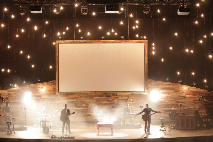 Pallets and hanging light bulbs  http://www.churchstagedesignideas.com/wp-content/uploads/2013/01/noid-Stage_-_7_Manger_Lights.jpg