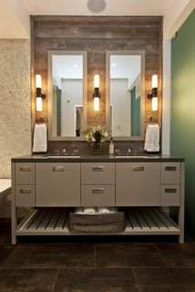 reclaimed wood behind mirrors. mirrors framed in same color as vanity, wood wall framed