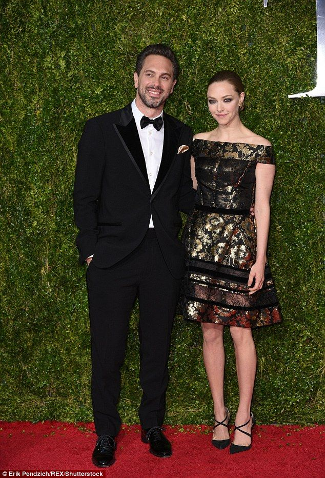 I'm pregnant! Amanda Seyfried revealed on Tuesday night that she's expecting her first child with fiance Thomas Sadoski (the couple are seen in a file picture from June)