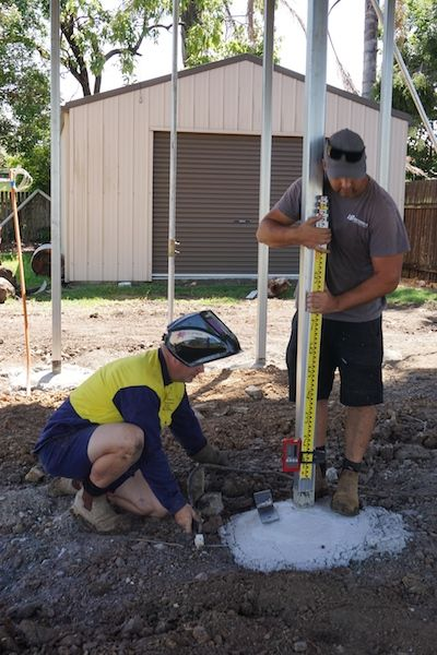 The builder and welder ensuring the lugs to hold the subfloor are level before tacking into place. #houseraise #renovation