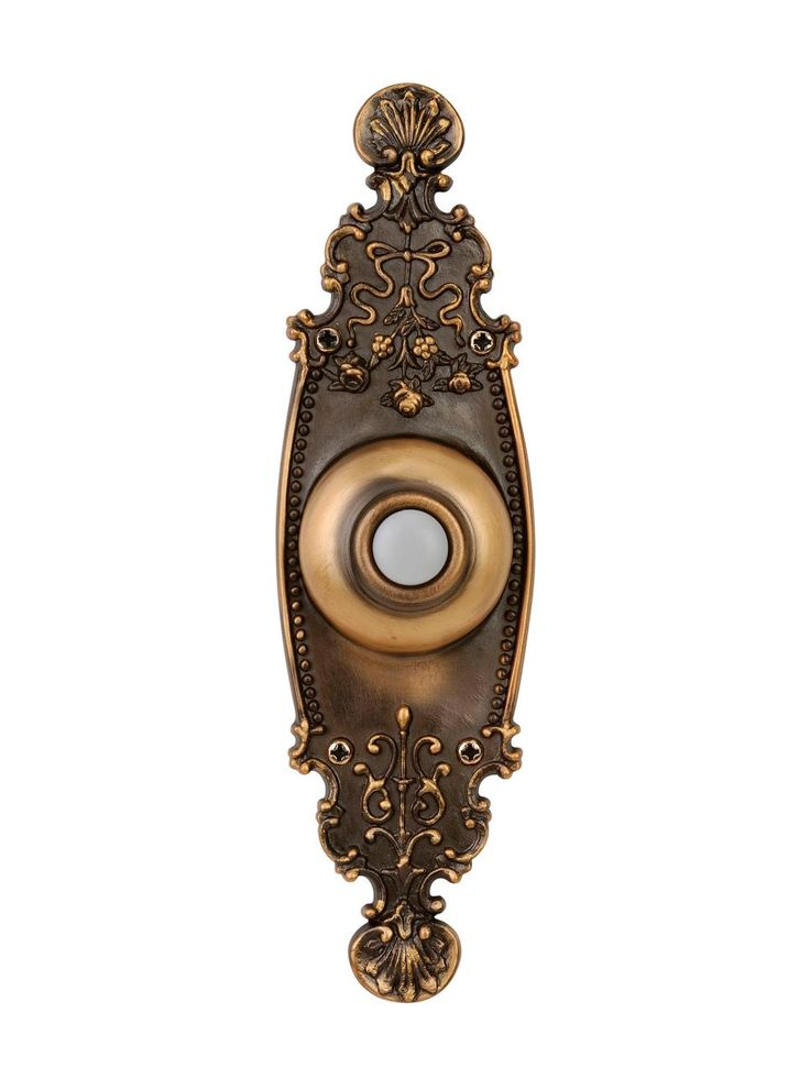 One trimmed with intricate metalwork is perfectly suited to the 100-year-old home. Crest burnished brass doorbell button with LED light, $27.50, lampsplus.com