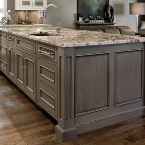 inset doors with beaded face frame openings, gray painted island, grey kitchen island, black glaze, square columns, furniture base, panelized ends, under mount sink, custom