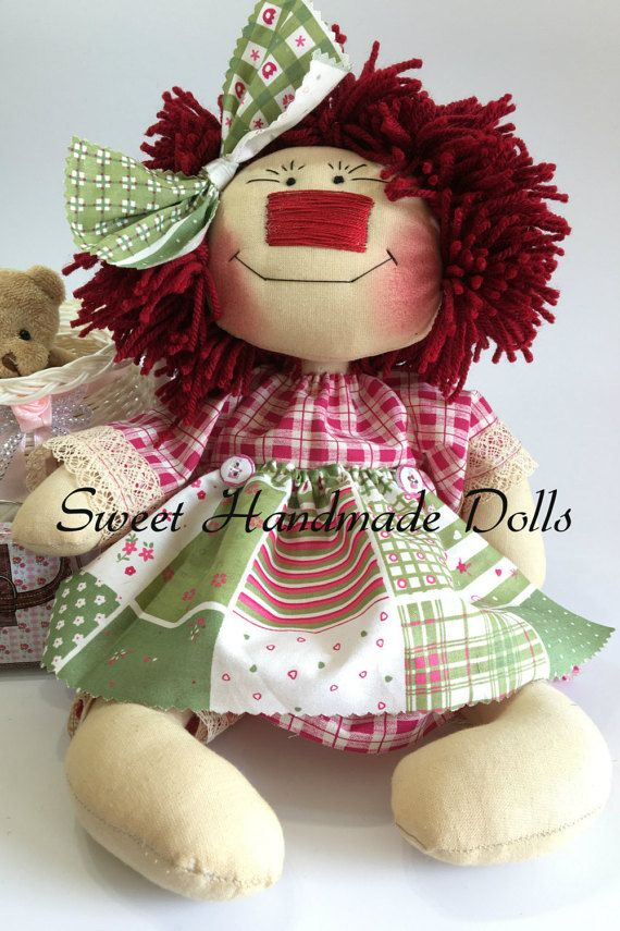 "Raggedy Ann Doll with a garnet dress and a green apron -Rag Doll-Fabric Doll-Handmade Doll-Textile Doll-Home Decoration-Handmade Toy  Raggedy Ann is a 35cm (14"") fabric doll, part of our new 'Country Collection'. She is our personal adaptation of the traditional doll Raggedy Ann   Ann has beautiful red hair made of wool. Her body is dyed with coffee, cinnamon, vanilla and cloves, which gives her a very pleasant smell. Her dress is made with 100% cotton fabrics. She is wearing a beautiful…"