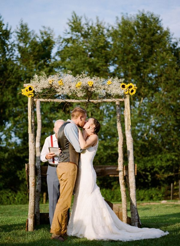 DIY arbor with sunflowers and babys breath