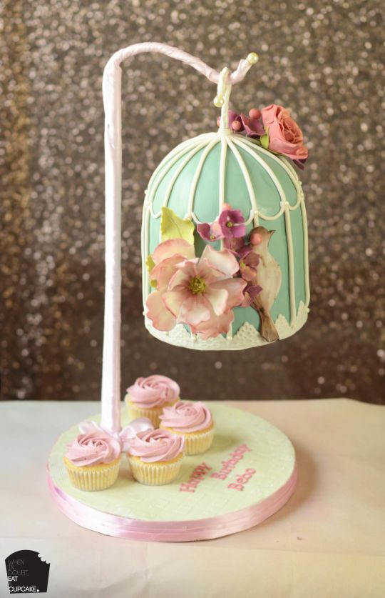 Gravity defying bird cage cake