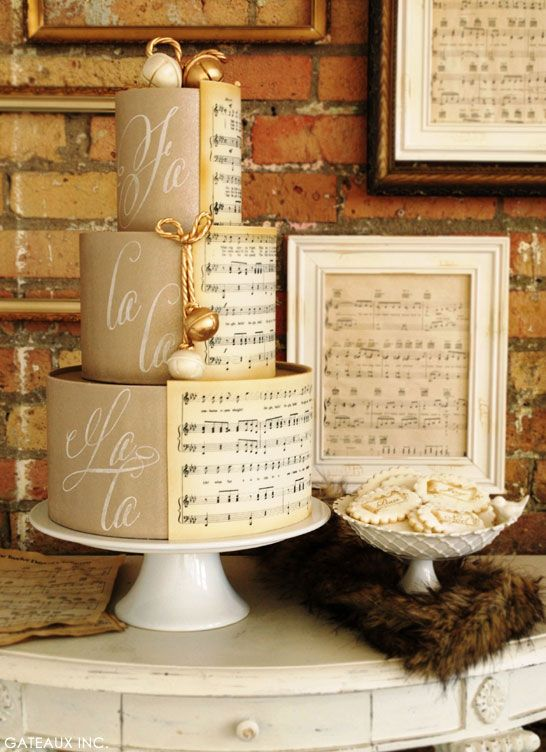 Beautiful, elegant sheet music cake in parchment, creams and golds.