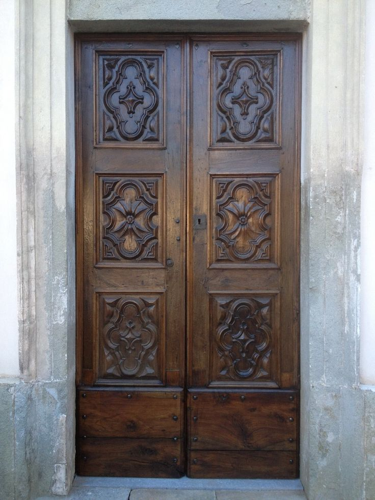 Wood door of the church of Santissima