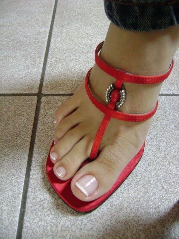3e0cbf04a women feet in thong sandals high heels
