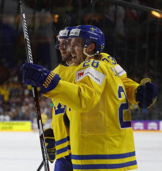 Elias Lindholm Photos Photos - Elias Lindholm of Sweden celebrates scoring his goal during the 2017 IIHF Ice Hockey World Championship game between Sweden and Russia at Lanxess Arena on May 5, 2017 in Cologne, Germany. - Sweden v Russia - 2017 IIHF Ice Hockey World Championship