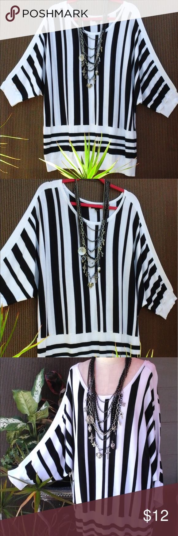 """""""ana"""" black and white striped top This black and white striped top is made of a lightweight sweater type fabric. It has a round neck and batwing sleeves. Top is made of 60% rayon and 40% cotton. The length from the back of the neck to the hem is 29"""" ana Sweaters Crew & Scoop Necks"""