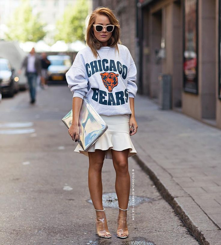 Chicago Bears sporty sweatshirt styled with a flirty skirt and heels | Street Style: 25 Cool Sweatshirt Outfit Ideas
