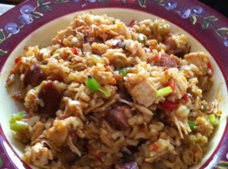 My family loves this dish. It's great on weekends when everyone is watching college or pro football games and could also be made ahead and warmed up in a crockpot for tailgating if you had electricity. We also like it during the holidays, but you could make it most anytime.  This is similar to one of Emeril's jambalaya recipes, but I like a little tomato in mine (red jambalaya) I also use brown rice and white meat only chicken.