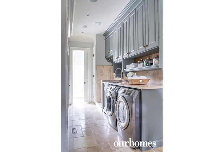 "The laundry room is tucked away but still easily accessible on the main floor.    See more of this home in ""Alder Cabinetry with Visible Knots Bucks the White Trend"" from OUR HOMES York Region, Summer 2017 http://www.ourhomes.ca/articles/build/article/alder-cabinetry-with-visible-knots-bucks-the-white-trend"