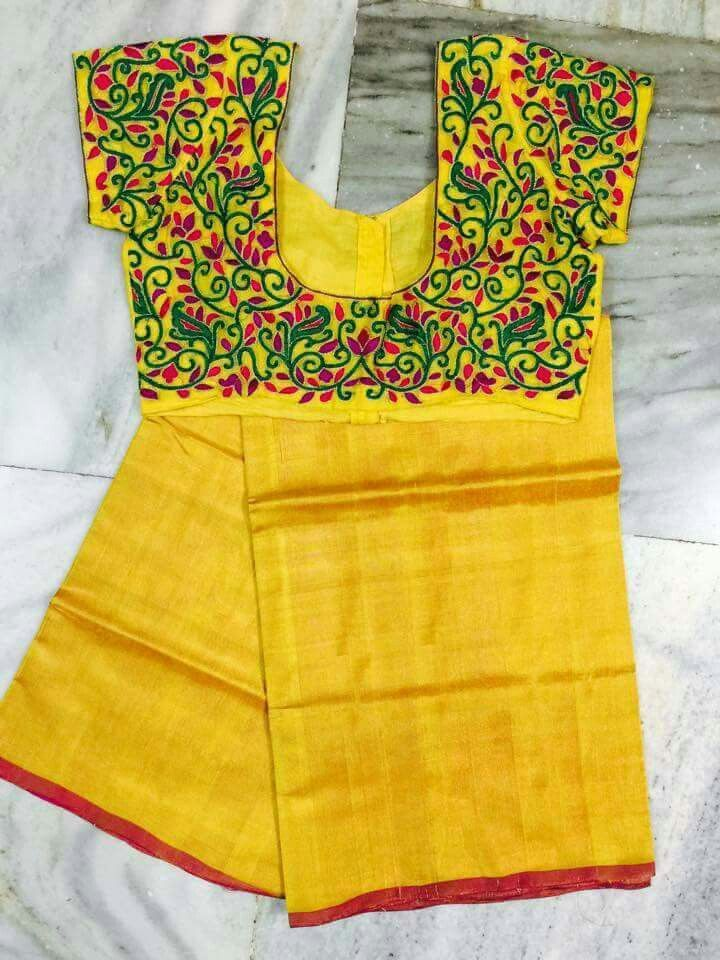 Plain yellow saree highlighted with heavy embroidery