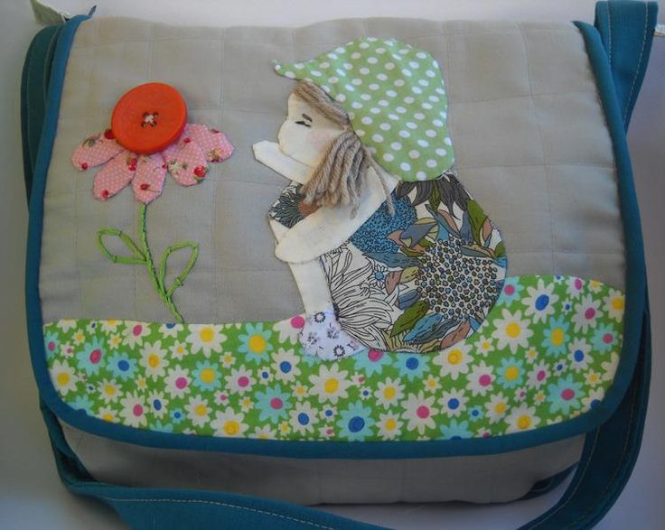 handmade quilted purse with litle girl and flower sewing by the hand