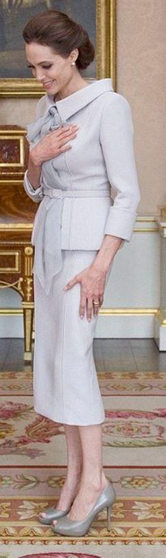 Angelina Jolie: Shirt and skirt – Ralph & Russo  Shoes – Salvatore Ferragamo