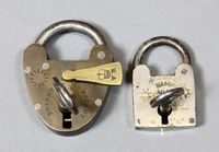 """Lot 257 A Victorian miniature brass heart shaped padlock marked Patented 1"""", together with a square steel padlock marked Handmade £50-80"""