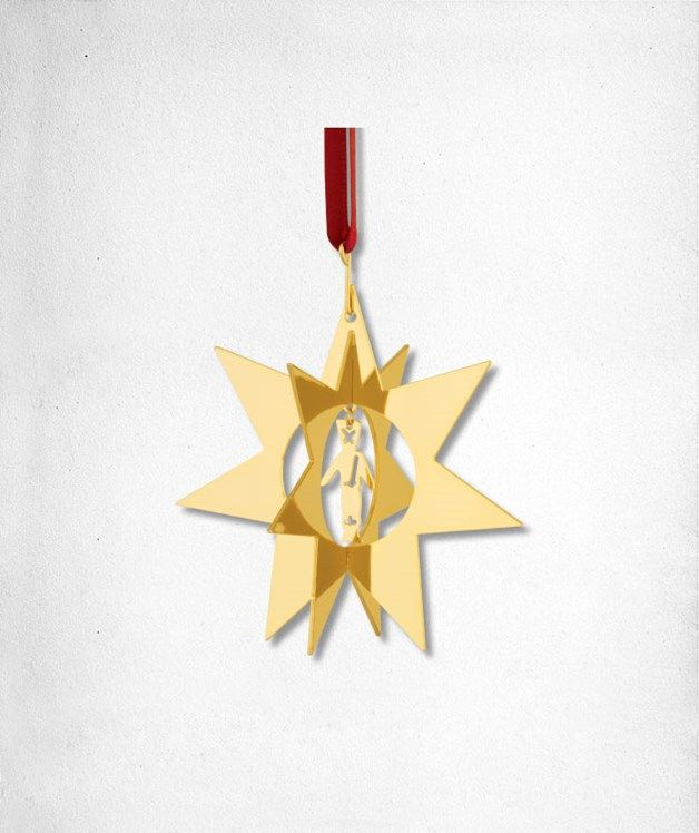 Star Soldier- Star with figure in the middle in goldplated brass. The ribbon can be removed so the star can stand.