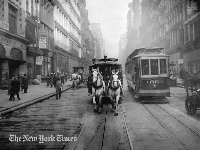 """Horse Cars Last Days - 1917. Just before the last of these vehicles was banished from the streets of New York City, a photographer snapped one of them as it passed alongside a """"Modern Electric Car."""""""
