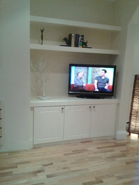 TV units come storage units with floating shelves above in any color or size to meet your specifications
