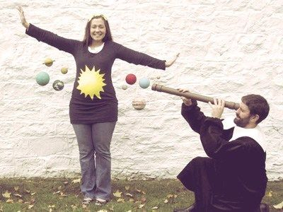 Solar system pregnant mama costume, love it! And, yes, your baby will think it's the center of the universe (like it should!)