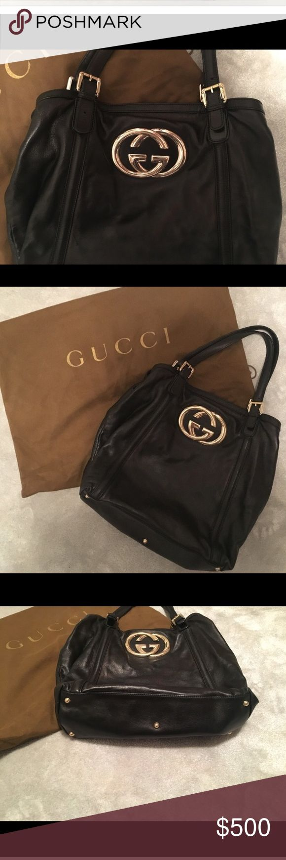 Gucci black leather tote with emblem *AUTHENTIC* This bag can definitely be considered vintage.  Bought from the Gucci store years ago and still in EXCELLENT condition.  Perfect tote for the working gal or if you just have a ton of stuff.  Has metal feet to protect bottom of the bag.  Inside of the bag is mint condition.  Comes with original dust bag. Price always negotiable! Gucci Bags Totes