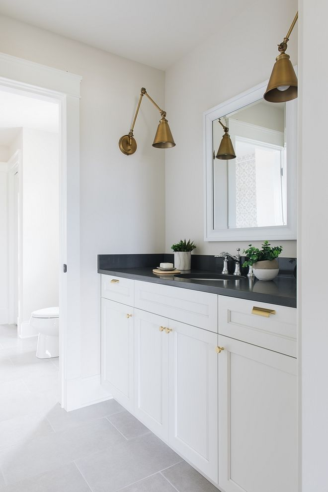 The Jack Jill Bathroom Has A Clean And Uncomplicated Design Trim And Cabinet Paint Col White Interior Design Bathroom Interior Design White Bathroom Interior