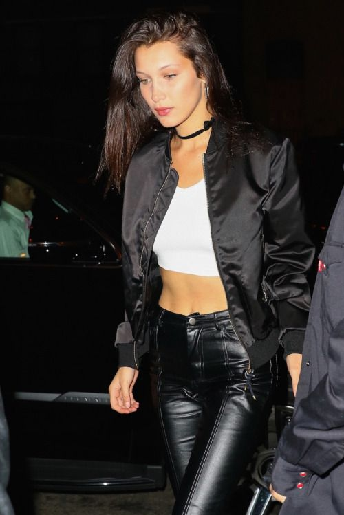 Bella Hadid rocking black leather pants with a white top and a black bomber jacket! Xoxo F