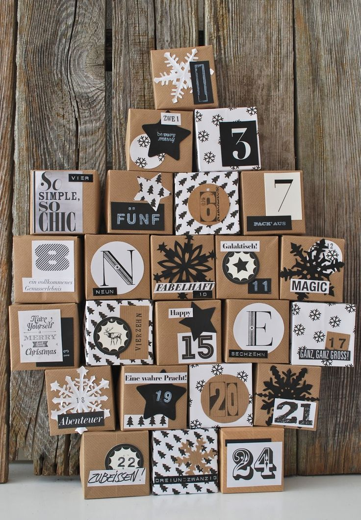 boxes wrapped in kraft and decorated with black and white elements