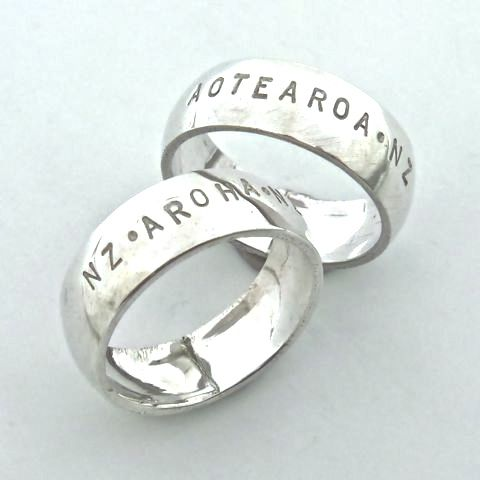 "Valentines Jewellery; made in New Zealand.  ""Aroha"" band in sterling silver"
