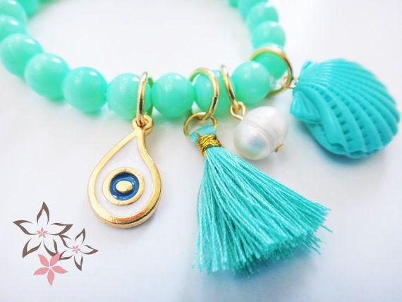 Summer Island  Beautiful summer inspired handmade boho beach charm bracelet with turquoise acrylic beads adorned with turquoise acrylic shell, fresh