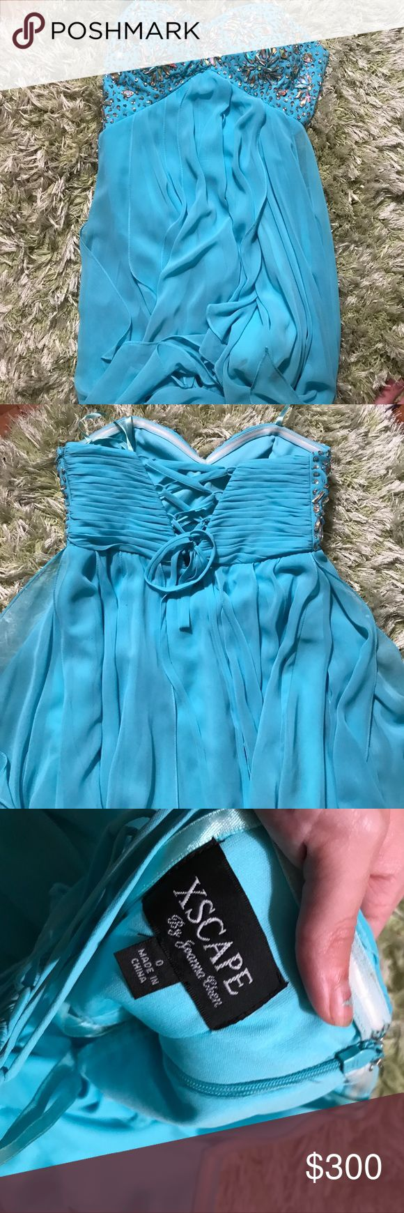 Formal dress Bought for prom but never wore it! Good for weddings or other special events. Mullet dress with empire waist. Size 0 and originally $400. New without tag Xscape Dresses High Low