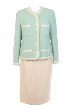 LOT:51   CHANEL - a mint green and cream suit.